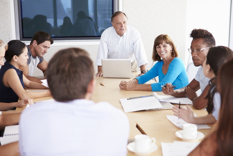 A group of employees attending a meeting.